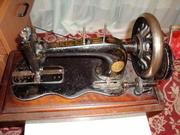 Швейная машинка Зингер! очень в хорошем состоянии и можно спокойно шит